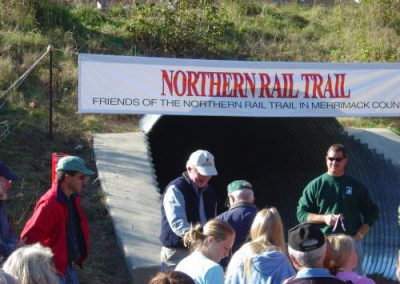 George Burdick accepts a golden spike in appreciation for all the time and energy he has donated to the Northern Rail Trail.