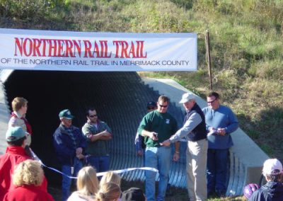 Craig Mayo cuts the ribbon to officially open this 1.7 mile of walking trail.